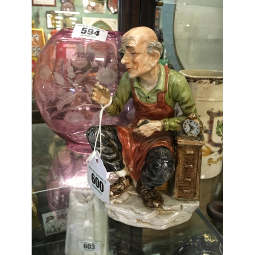 600 - Ceramic model of a watchmaker....