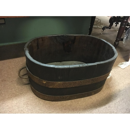 713 - C19th. Oak foot bath with metal hoops....