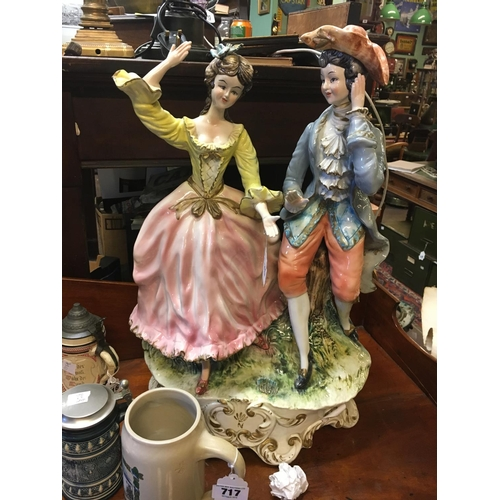 715 - Ceramic figural group of and lady and a gentleman in the C19th. Style....