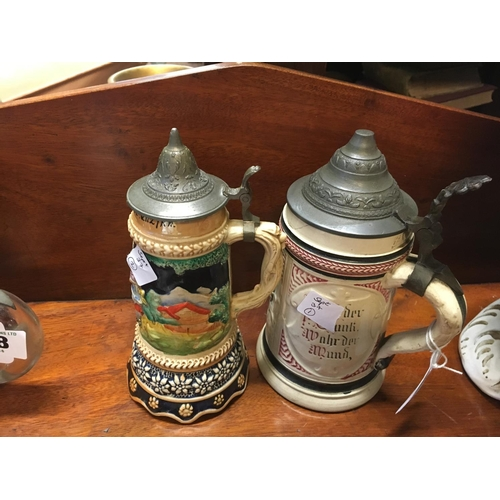 716 - Early C20th German beer stein and German musical beer stein....