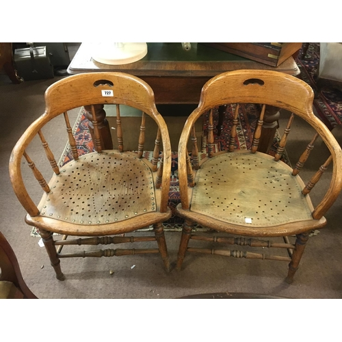 727 - Pair of oak elbow chairs....