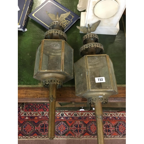 732 - Pair of brass trap lamps....