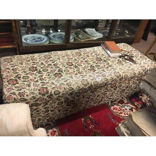 750 - Upholstered ottoman....