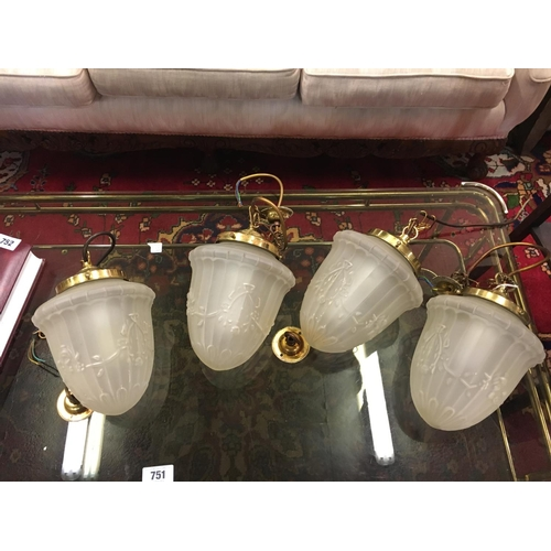 753 - Four brass and glass hanging lights....
