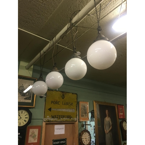 768 - Set of four1920's brass and opaline glass hanging lights with original brass brackets....