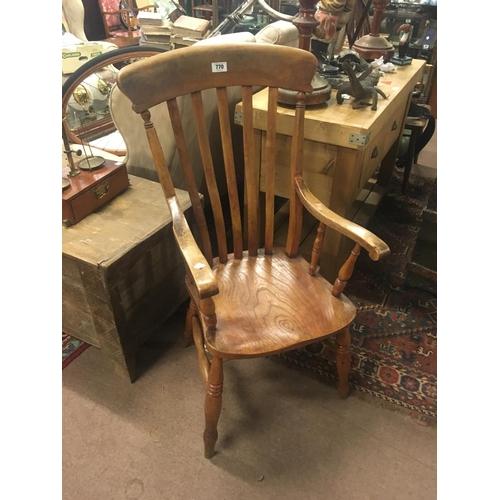 770 - Good quality ash and elm slat backed armchair....