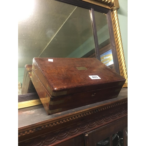 823 - Victorian mahogany and brass writing box with fitted interior....