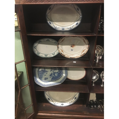 825 - Four shelves of C19th. joint dishes....