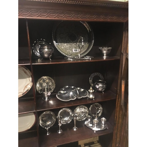 826 - Three shelves of miscellaneous silver plate....