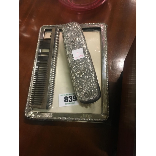 839 - Silver photo frame, brush and comb set....