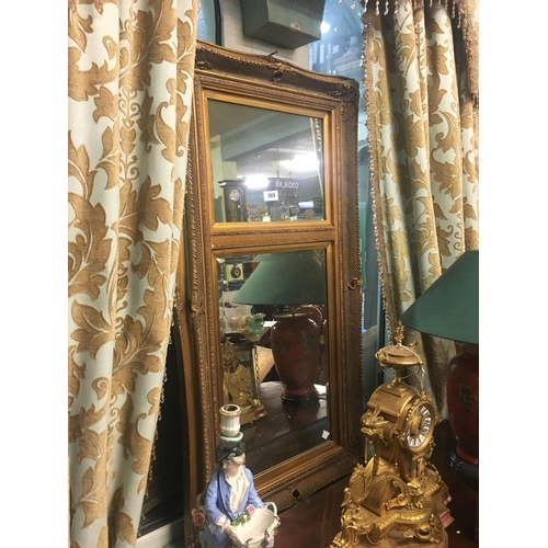 869 - Gilt bevel edged mirror....