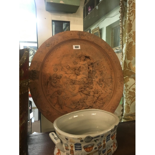 880 - Terracotta circular wall plaque....