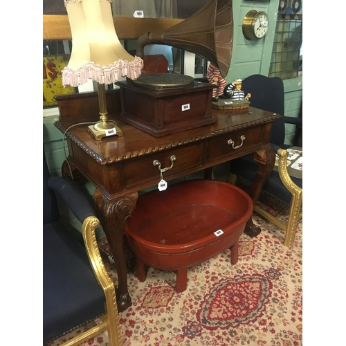 908 - Edwardian mahogany side table with two drawers in the freize on claw and ball feet.200...