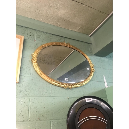 960 - Gilded oval wall mirror....