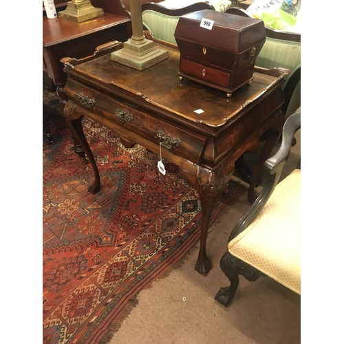 989 - Victorian walnut silver table with drawer in frieze on claw and ball feet....