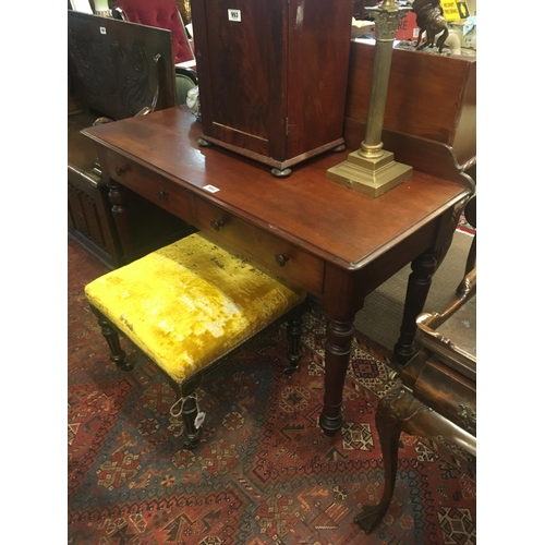 995 - C19th. mahogany side table with two drawers in frieze on turned legs with brass castors. Stamped STR...