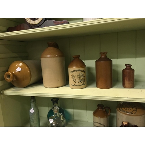 106 - Five stoneware flagons....