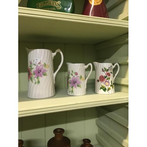107 - Three floral jugs....