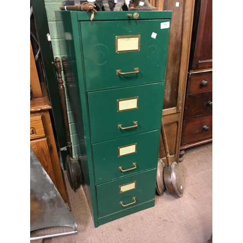 11 - Four drawer metal filing cabinet with key....
