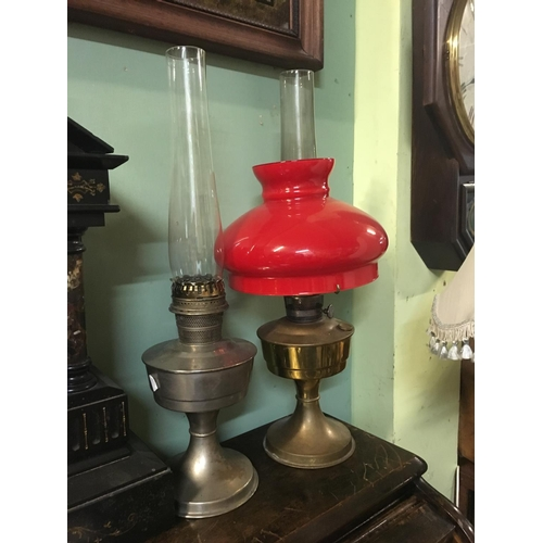 114 - Brass Aladdin lamp with red shade and another....