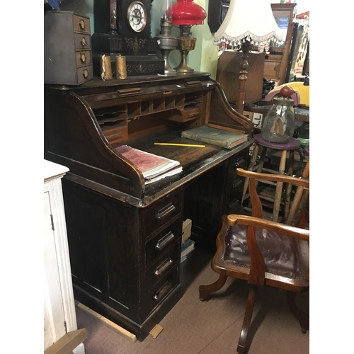 115 - 1920's oak roll top desk....