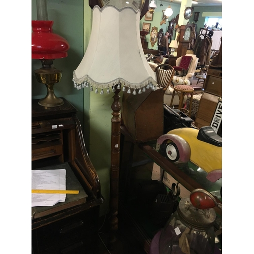 119 - Edwardian walnut standard lamp....