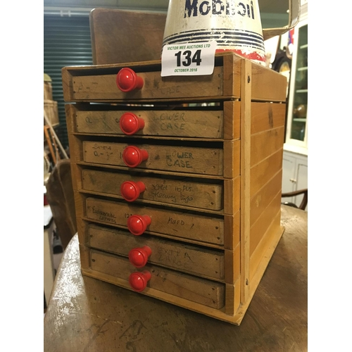 134 - 1930's seven drawer walnut  cabinet with printing punches...
