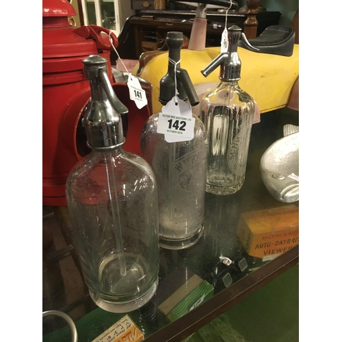 142 - Three 1930's soda siphons....