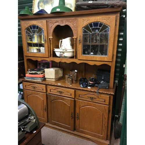 22 - Modern oak kitchen dresser with leaded doors....