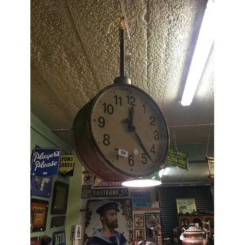 250 - Large round faced railway station clock....