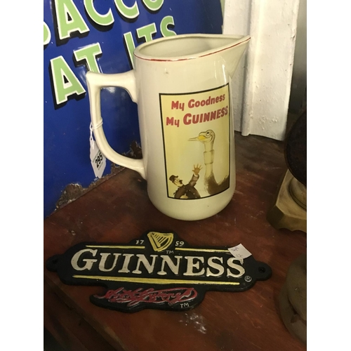 295 - Cast iron GUINNESS plaque and a GUINNESS jug,...