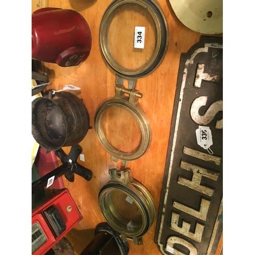 334 - Four brass ship's portholes....