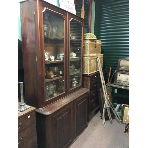 34 - C19th. mahogany library bookcase with two glazed doors over two panelled doors....