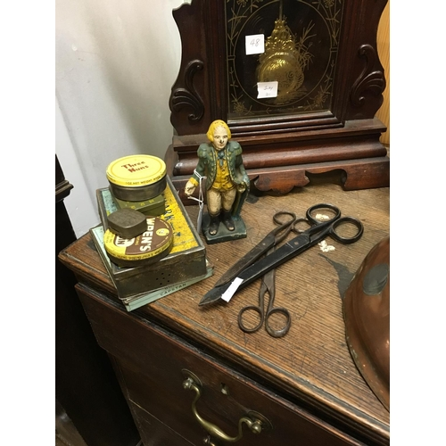 49 - Misc. lot of advertisement tins, cast iron figure and three pairs of scissors....