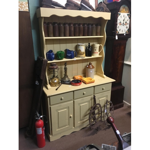94 - Painted pine dresser with two shelves over three drawers over two panelled doors....