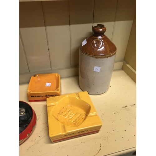 96 - Two advertisement ashtrays and a flagon....