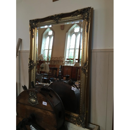 106 - Gilt framed bevelled edge mirror....
