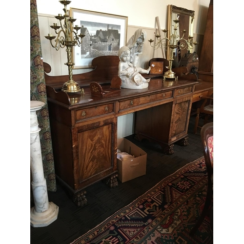 113 - Regency twin pedestsal gallery back sideboard with carved lion paw feet....