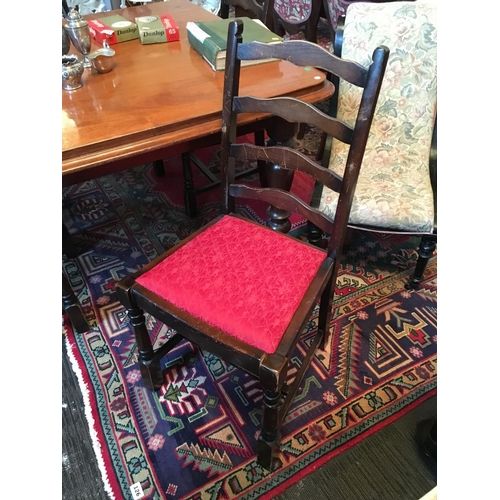 125 - Four ladder back chairs....