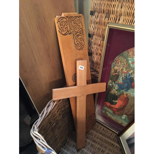 143 - Cross, carved wood panel and cushions....