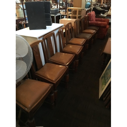 210 - Set of eight art deco oak chairs....