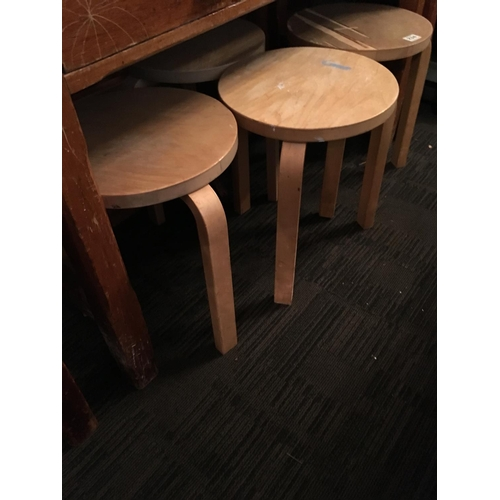 234 - Four wooden stools....