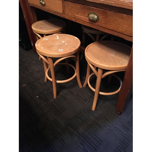 242 - Four bentwood stools....