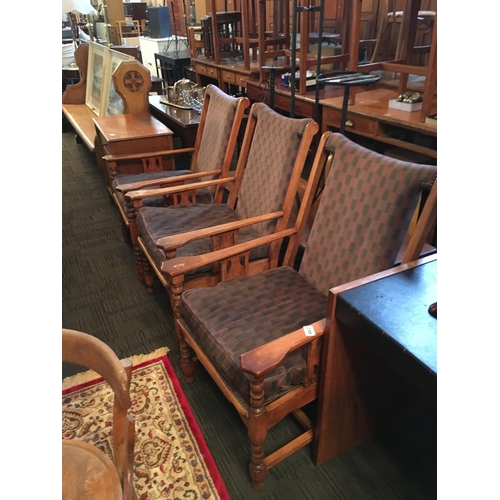 248 - Three oak framed armchairs....