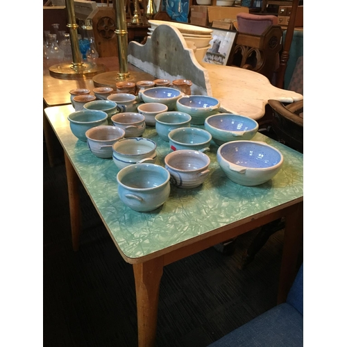 265 - Pottery cups and bowls....