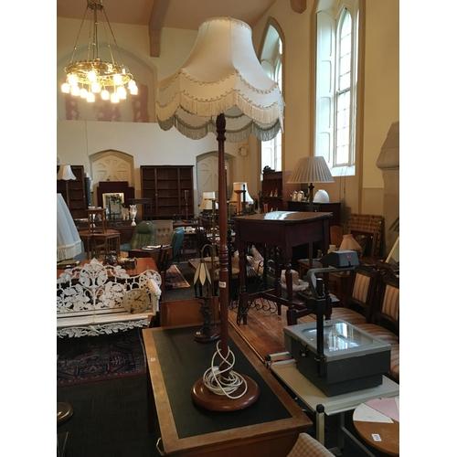 275 - Mahogany standard lamp and shade....