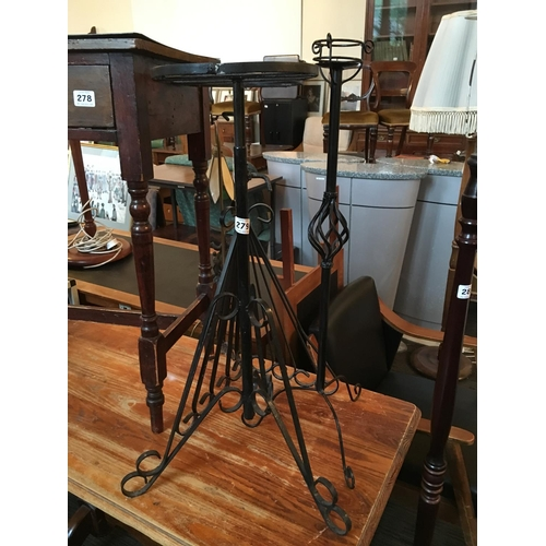 279 - Two metal plant stands and candle stand....