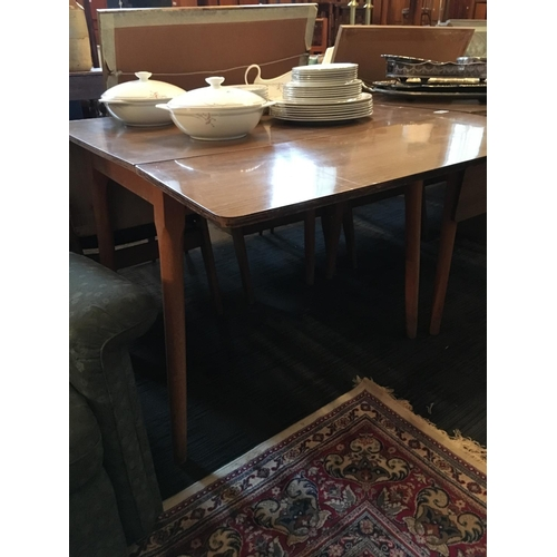296 - Drop leaf kitchen table....