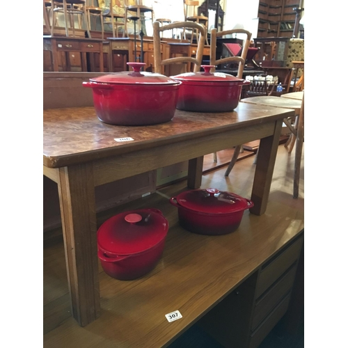 305 - Four cast metal casserole dishes....