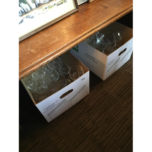 312 - Two boxes of wine glasses....